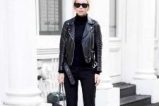 a black turtleneck, flare trousers, boots, a leather jacket and a mini bag for a chic look every day