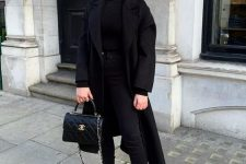 a black turtleneck, skinnies, platform boots, a bag and a midi coat for a comfrotable fall look