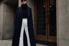 a black turtleneck sweater, white jeans, snakeskin print booties, a navy maxi caot will keep you warm on a cold day