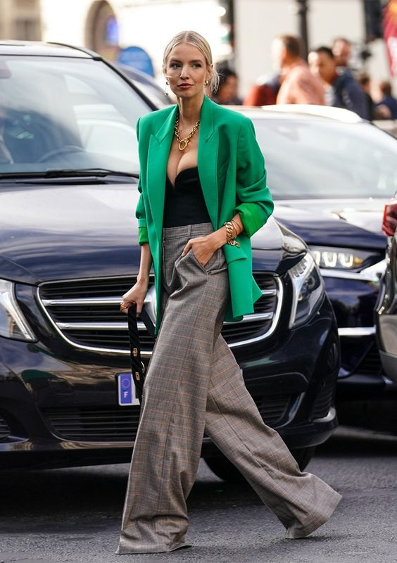 a bold outfit with a black strapless bodusuit, an apple grene oversized blazer, grey plaid palazzo pants and a black bag