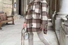 a brown hoodie, a plaid shirt jacket, off-white leather leggings, matching boots and a grey bag
