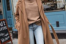a brown turtleneck and a midi coat, blue jeans, beige snakeskin print boots for a lovely fall look