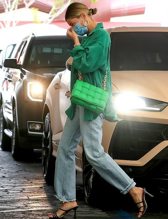 a chic fall look with a grene corduroy blazer, blue jeans, black heels, a bold green woven bag is a lovely solution