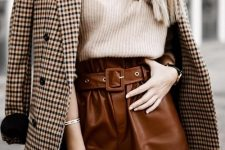 a creamy turtleneck, cognac leather shorts, tights, a tan plaid blazer for a stylish fall look suitable for work