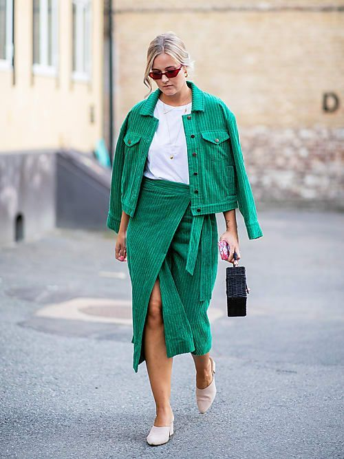 a creative and bright fall look with an emerald corduroy suit - a jacket plus a wrap skirt, a white t-shirt and neutral mule splus a black bag