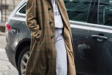 a grey hoodie and sweatpants, burgundy boots, a plaid beige coat for a comfy fall look