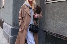 a grey hoodie, sweatpants, trainers, a beige trench and a black bag for a comfy and cozy fall look