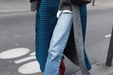 a grey sweater over a white t-shirt, blue jeans, blue plaid coat, red metallic boots, a black scarf and a printed bag