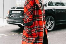 a grey turtleneck and blazer, black jeans, black combat boots, a red plaid midi coat and a striped bag