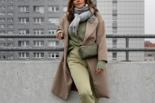 a lovely fall outfit with a green sweatshirt, sweatpants, white sneakers, a beige coat, a grey scarf and a green bag for every day