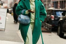 a neon green hoodie and sweatpants, neone yellow sneakers, an emerald coat and a black faux fur bag for a statement