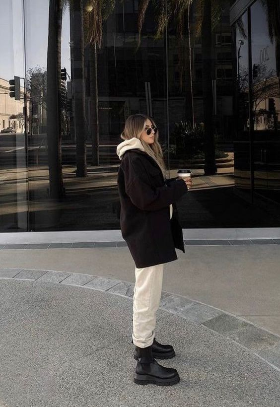 a neutral oversized hoodie and sweatpants, black boots and a black cropped coat for a super cool outfit