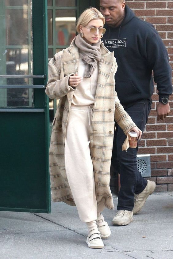 a neutral sweatshirt, matching sweatpants, sneakers, a plaid coat and a taupe scarf for a very comfy fall outfit