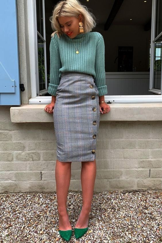 a pale green jumper, a grye plaid midi skirt on buttons, green heels and cool jewelry for work