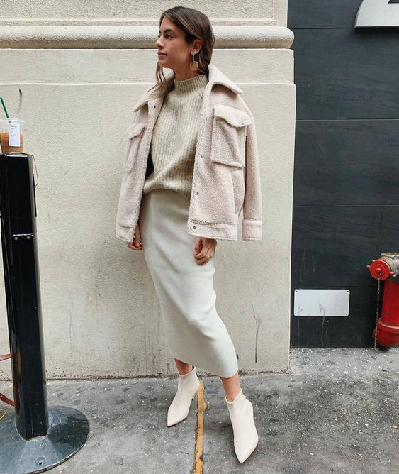 a pretty neutral outfit with a ribbed turtleneck, a creamy pencil skirt, white bootties and a neutral teddy jacket