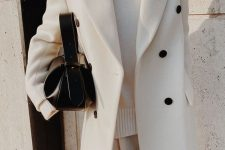 an all-white fall outfit with a coat