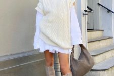 a white mini shirtdress, a creamy sweater over it, grey knee boots, a grey woven bag for a super trendy outfit