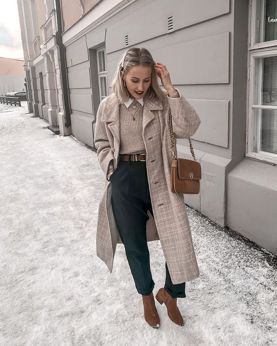 a white shirt, a tan sweater, black trousers, a brown belt, booties, a bag and a greige plaid midi coat for work