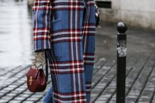 a white turtleneck, blue jeans, white boots, a blue and red plaid midi coat and a burgundy bag for a bold fall look