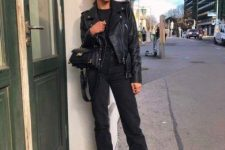 an all-black outfit with a jumper, cropped jeans, chunky boots, a leather jacket and a mini bag for the fall
