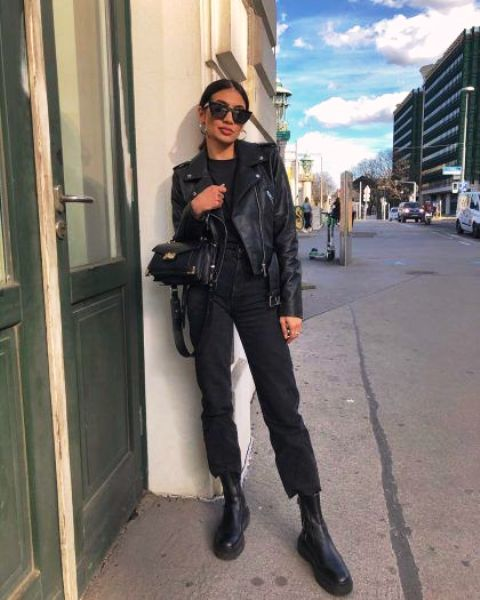 an all black outfit with a jumper, cropped jeans, chunky boots, a leather jacket and a mini bag for the fall