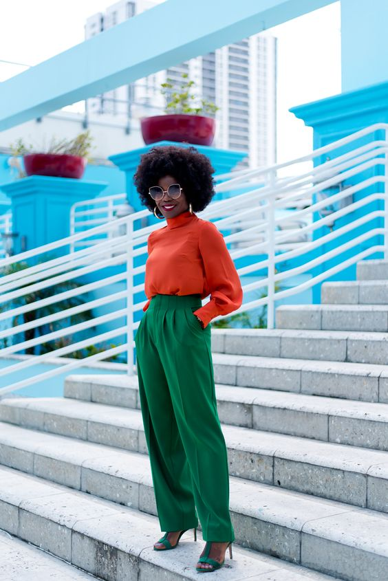 an orange turtleneck, emeral high waisted trousers and matching shoes for a super bright career look