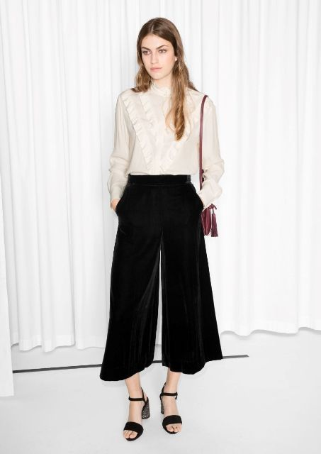 With beige blouse, black ankle strap shoes and marsala tassel bag