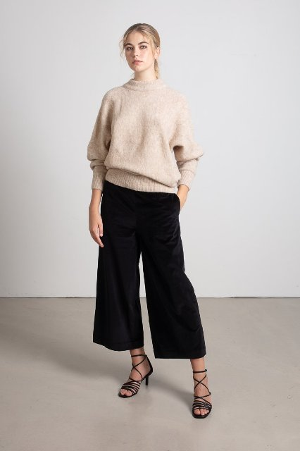 With beige loose sweater and black lace up sandals