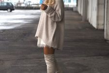 With beige oversized sweater and white lace mini dress