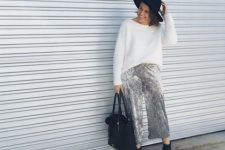 With black hat, white loose sweater, black tote bag and ankle boots