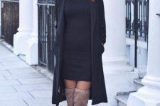 With black mini dress, oversized sunglasses and black midi coat