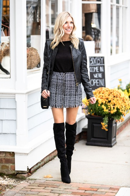 With black shirt, black leather jacket, black bag and black over the knee boots