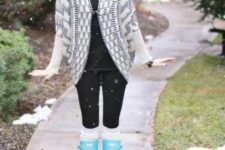 With black shirt, black leggings and gray and white printed cardigan
