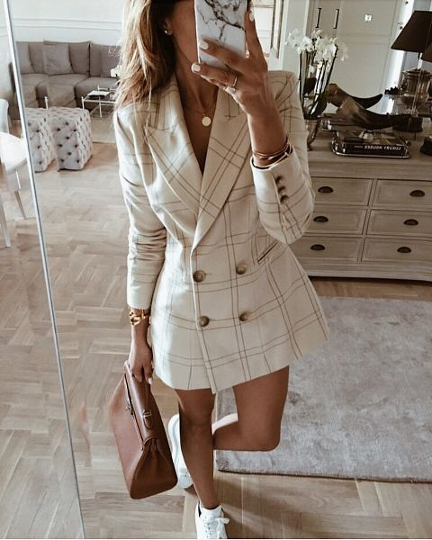 With brown leather bag and white sneakers