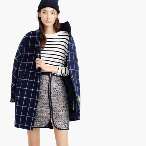 With hat, striped shirt and navy blue and white checked coat