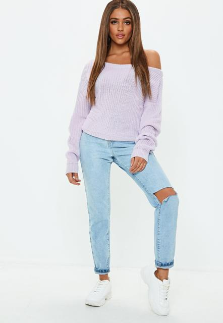 With light blue distressed cuffed jeans and white sneakers