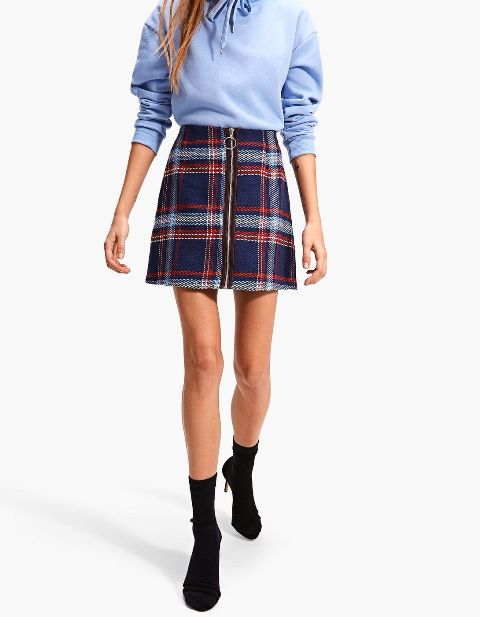 With light blue hoodie sweatshirt and black suede sock boots