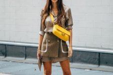 With long shirt, tweed skirt and yellow crossbody bag