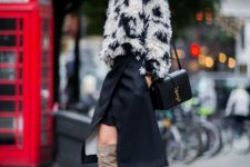 With navy blue and white faux fur jacket, asymmetrical skirt and black leather bag