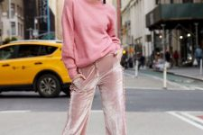 With pale pink loose sweater and beige ankle strap high heels