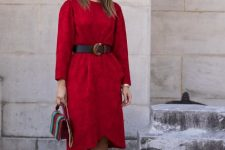 With red knee-length dress, brown belt and colorful bag