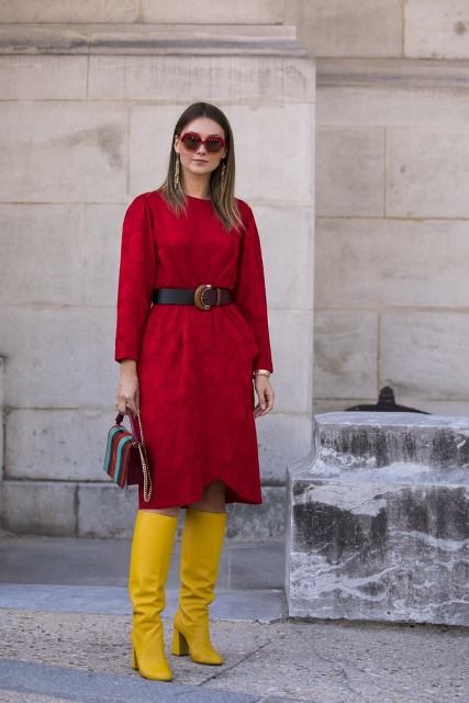 With red knee length dress, brown belt and colorful bag