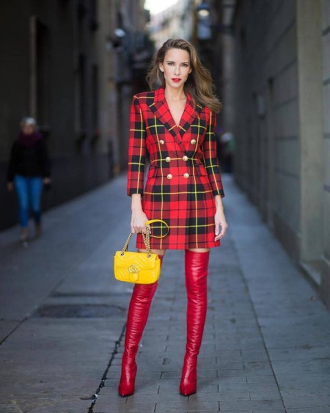 With red leather over the knee boots and yellow chain strap bag
