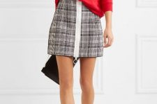 With red loose sweatshirt, black clutch and white ankle boots