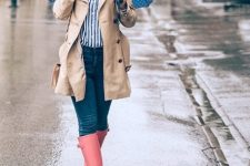 With striped button down shirt, jeans and beige trench coat