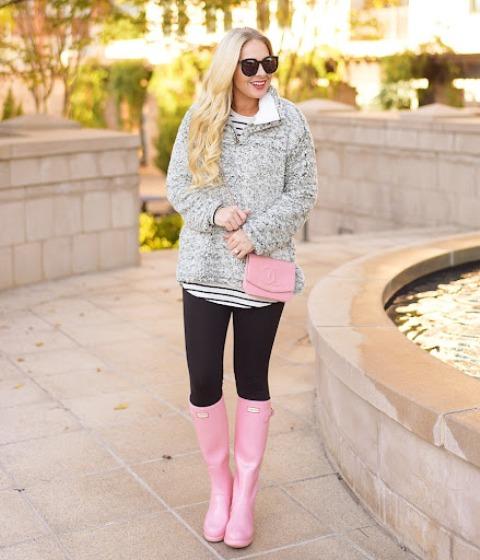 With striped shirt, sweatshirt, black leggings and pale pink mini bag