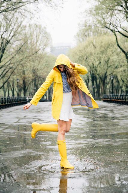 With striped shirt, white mini skirt and light yellow coat