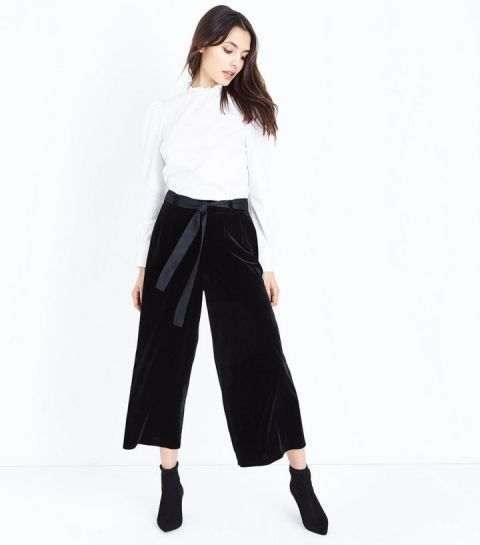 With white blouse and black ankle boots