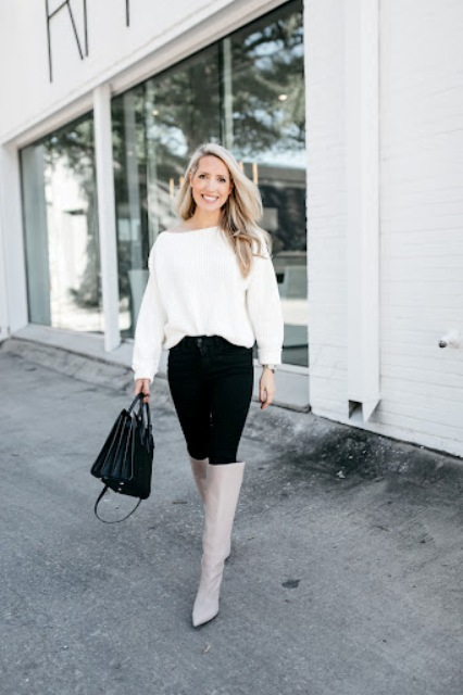 With white loose sweater, black bag and black trousers