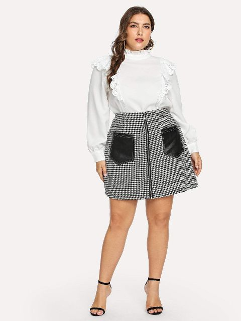 With white ruffled blouse and black ankle strap high heels